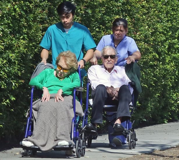 0_PAY-Kirk-Douglas-101-and-Anne-Buydens-99-seen-on-an-outing-with-their-caretakers.jpg