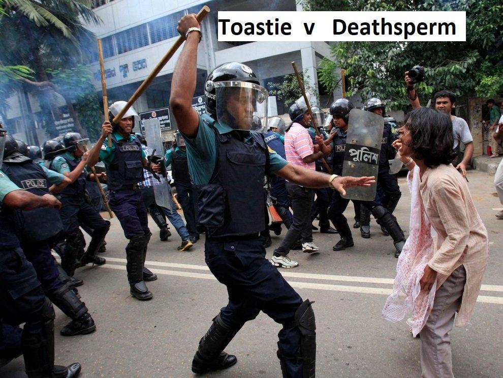 bangladesh-riot-beating-woman-with-baton.jpg